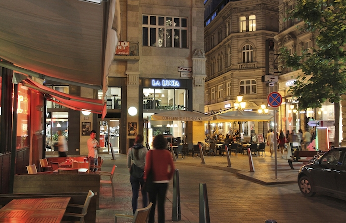 BUDAPEST, HUNGARY - JUNE 21, 2014: People visit Old Town in the evening in Budapest. 3.3 million people live in Budapest Metropolitan Area. It is the largest city in Hungary and 9th largest in the EU.